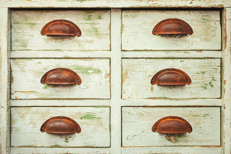 drawers: Vintage cabinet with six drawers and rusted handles Stock Photo
