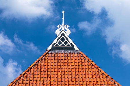 Detail of the decorated roof of an ancient frisian Dutch farm photo