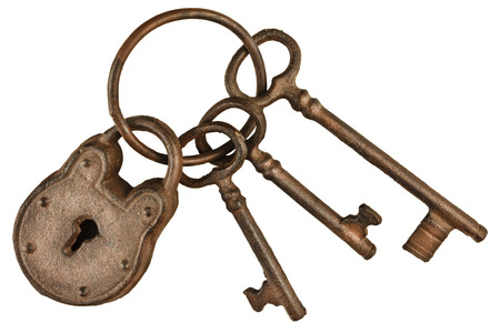 antique key: Rusted lock and keys attached on a keyring isolated on a white background
