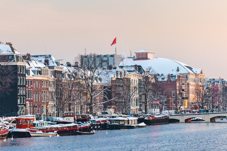 amstel: Amsterdam winter view with the river Amstel in front during sunset