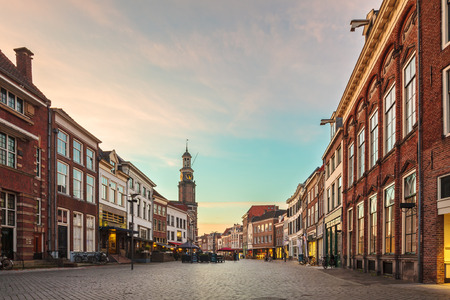 Ancient row of houses in the historic Dutch city of Zutphen during sunset