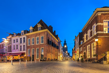 Ancient houses on a square in the historic Dutch city of Zutphen during sunset Stockfoto