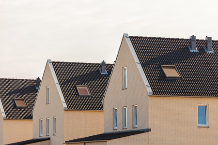 housing styles: Row of newly build contemporary houses in The Netherlands