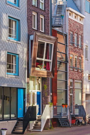 dutch canal house: Row of newly built Dutch contemporary canal houses in Amsterdam, The Netherlands Editorial