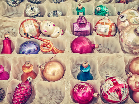 christmas tree purple: Retro styled image of old Christmas balls in a box