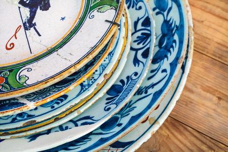 Medieval Dutch dishware from Delft on an old wooden table photo