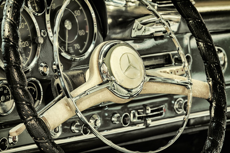 DREMPT, THE NETHERLANDS - NOVEMBER 19, 2014: Retro styled image of the dashboard of a 1960 Mercedes-Benz 190 SL Pagode in Drempt, The Netherlands