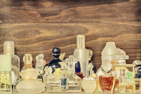 eau: DREMPT, THE NETHERLANDS - NOVEMBER 19, 2014: Retro styled image of different old perfume bottles in Drempt, The Netherlands Editorial