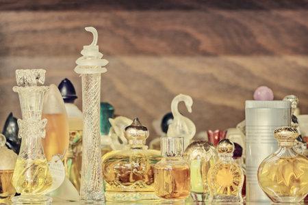 eau de toilette: DREMPT, THE NETHERLANDS - NOVEMBER 19, 2014: Retro styled image of different old perfume bottles in Drempt, The Netherlands Editorial