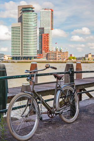 maas: Parked bicycle in front of the river Maas in Rotterdam, The Netherlands