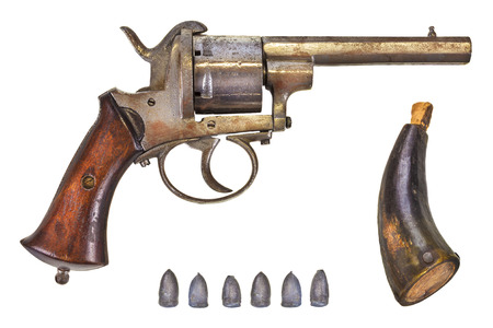 ammunition: Ancient revolver with six bullets and gun powder isolated on a white background