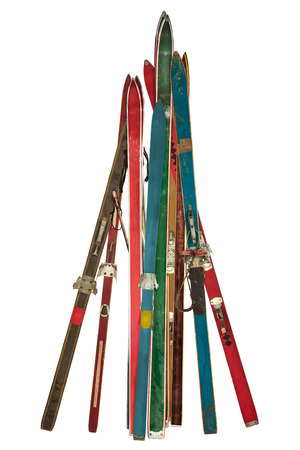 Vintage collection of different used skis isolated on a white background photo