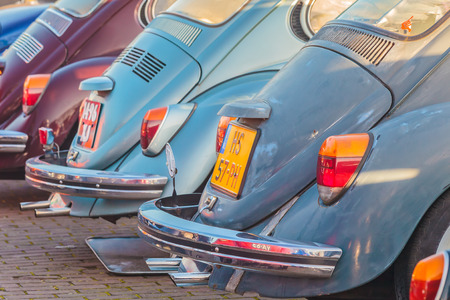 ROSMALEN, THE NETHERLANDS - JANUARY 4, 2015: Row of vintage Volkswagen Beetles from the seventies in Rosmalen, The Netherlands Editorial
