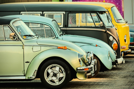 campervan: ROSMALEN, THE NETHERLANDS - JANUARY 4, 2015: Retro styled image of a row of vintage Volkswagen Beetles and Transporters from the seventies in Rosmalen, The Netherlands Editorial