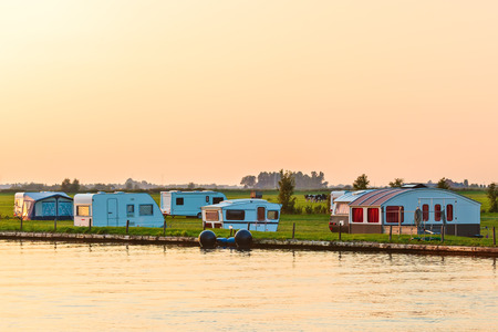 camping site: Dutch camping site in the province of Friesland during sundown Stock Photo