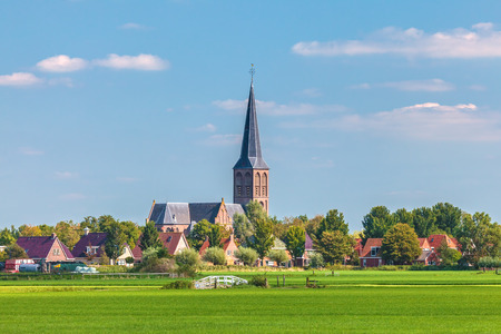 Small Dutch village with church in the province of Friesland 版權商用圖片 - 35952295