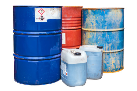 chemical hazard: Rusty toxic waste barrels isolated on a white background
