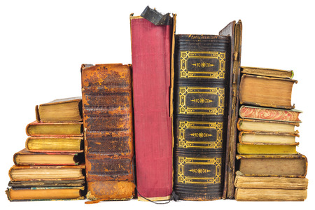 Different old worn books isolated on a white background photo