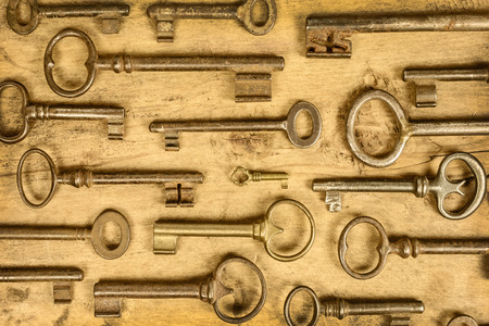 antique key: Variety of antique vintage keys on an old wooden background