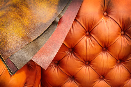 Chesterfield couch with different examples of leather coverings