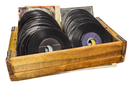 Retro styled image of a wooden box with vinyl turntable records isolated on a white background Stockfoto