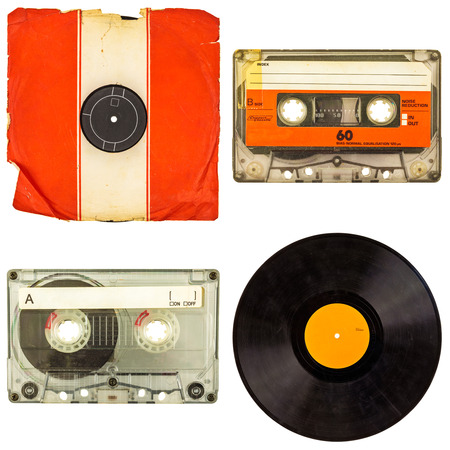 Set of retro compact cassettes and vinyl record albums isolated on a white background