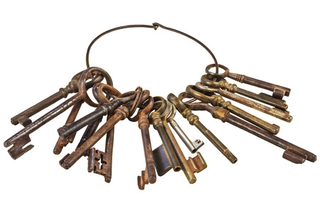 Set of vintage rusty keys attached on a ring isolated on a white background photo