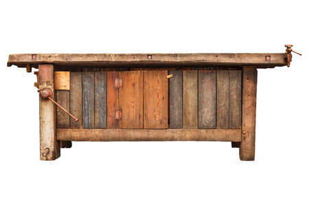 Old carpenter wooden work bench isolated on a white background Stockfoto