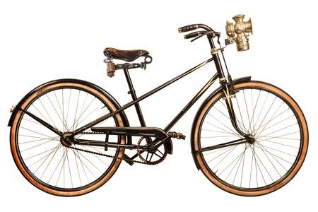 レトロなスタイルの白い背景で隔離のランタンと 19 世紀の女性の自転車のイメージ 写真素材