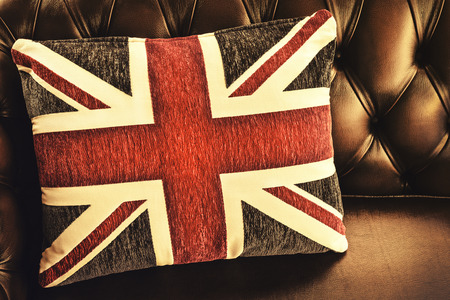 retro styled: Retro styled image of a cushion with the English flag on a chesterfield sofa
