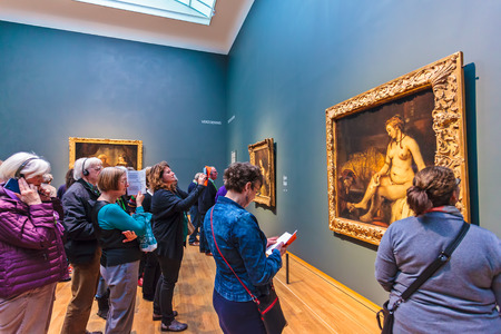 AMSTERDAM, THE NETHERLANDS - MARCH 12, 2015: Visitors of the 2015 exhibition at the Dutch Rijksmuseum dedicated to the late work of Rembrandt van Rijn in Amsterdam, The Netherlands