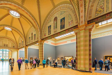 famous paintings: AMSTERDAM, THE NETHERLANDS - MARCH 12, 2015: View at the hall of the Dutch Rijksmuseum with famous paintings of Vermeer, Rembrandt and other medieval painters in Amsterdam, The Netherlands Editorial