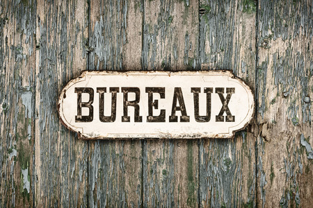 french text: Retro styled image of an old rusted metal sign with the French text