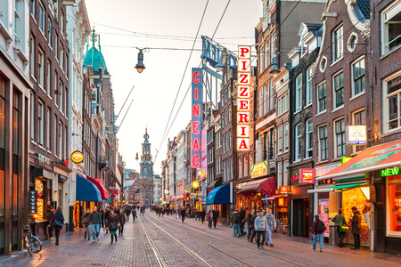 busy restaurant: AMSTERDAM, THE NETHERLANDS - MARCH 12, 2015: The always busy famous Reguliersbreestraat shopping area in Amsterdam, The Netherlands