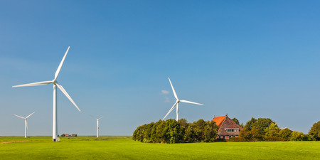 Panoramic image of a Dutch farm with wind turbines in the province of Friesland photo