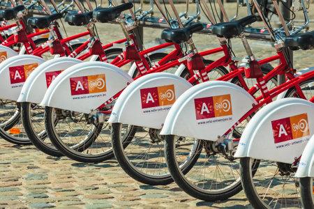 shared sharing: ANTWERP, BELGIUM - April 23, 2015: Row of public transport rental bicycles in Antwerp, Belgium Editorial