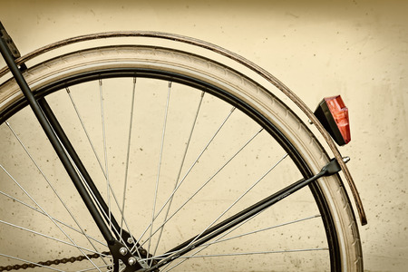 rear wheel: Retro styled image of a bicycle rear wheel with wooden fender
