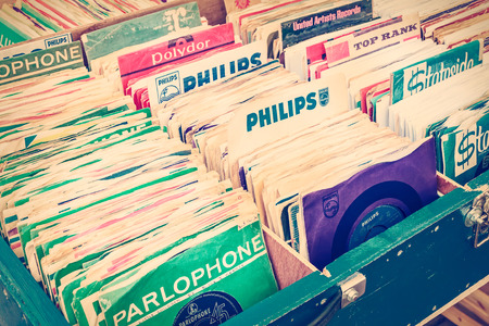 flee: ROSMALEN, THE NETHERLANDS - MAY 10, 2015: Retro styled image of boxes with vinyl turntable records on a flee market in Rosmalen, The Netherlands Editorial