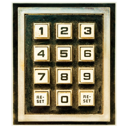 numeric: Vintage weathered keypad with reset and number buttons