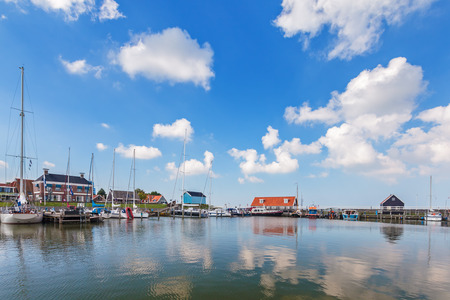 dutch: The Dutch harbor of Hindeloopen on a sunny summer day Editorial
