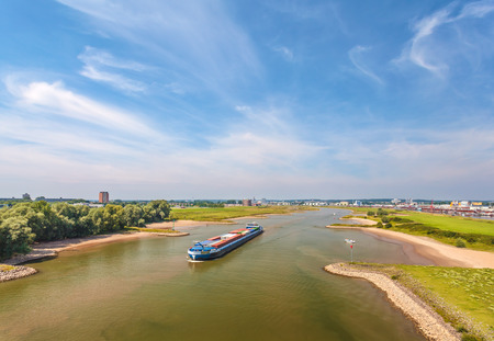 dutch: The Nederrijn river in front of the Dutch city of Arnhem, The Netherlands