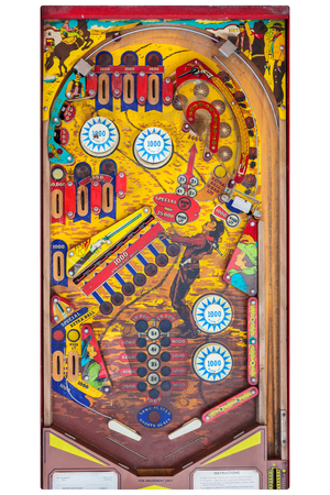 DIEREN, THE NETHERLANDS - MAY 10, 2015: Top view of a vintage pinball machine with western cowboy decoration in Dieren, The Netherlands