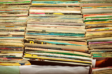 single songs: Retro styled image of boxes with vinyl turntable records on a flee market