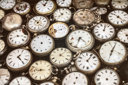 Retro styled image of old scratched and run down pocket watches Imagens