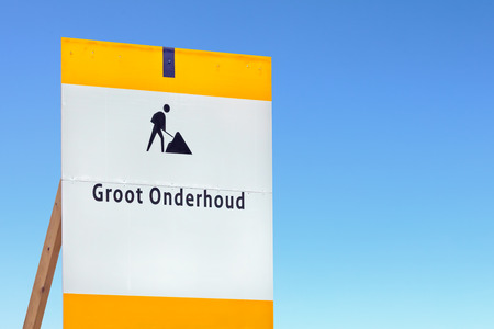 road closed: Road information sign with the Dutch text for large maintenance against a blue sky Stock Photo