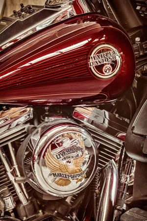 harley davidson motorcycle: DREMPT, THE NETHERLANDS - AUGUST 11, 2015: Retro styled image of the engine and fuel tank of a classic Harley Davidson motorcycle in Drempt, The Netherlands