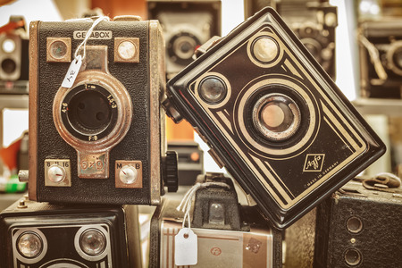 flee: DOESBURG, THE NETHERLANDS - AUGUST 23, 2015: Sepia toned image of old box cameras on a flee market in Doesburg, The Netherlands