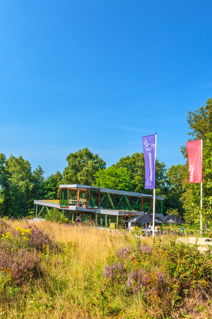 posbank: RHEDEN, THE NETHERLANDS - AUGUST 13, 2015: Summer view of tourist visiting center De Posbank in national park Veluwezoom with tourists sitting outside in Rheden, The Netherlands
