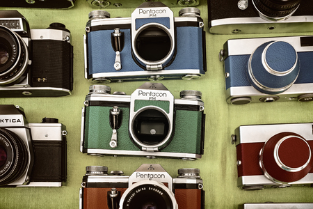 photo shooting: DOESBURG, THE NETHERLANDS - AUGUST 23, 2015: Retro styled image of colorful photo cameras on a flee market in Doesburg, The Netherlands
