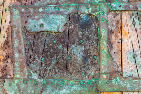 ship wreck: Part of a weathered ship wreck with old wooden planks and decayed metal